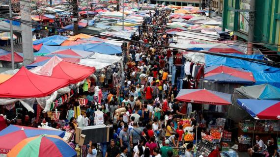 FILE-PHOTO-People-shop-at-a-street-market-in-Divisoria-Manila